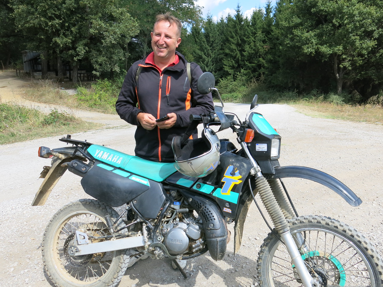 Local ranger Ljubishi on an old Yamaha DT125