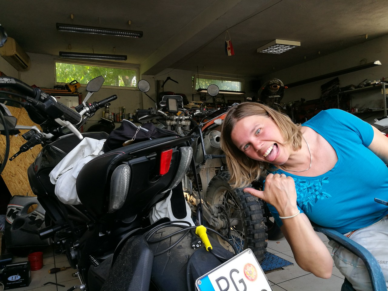 Sofie going crazy with some of the bikes in Vladan's garage