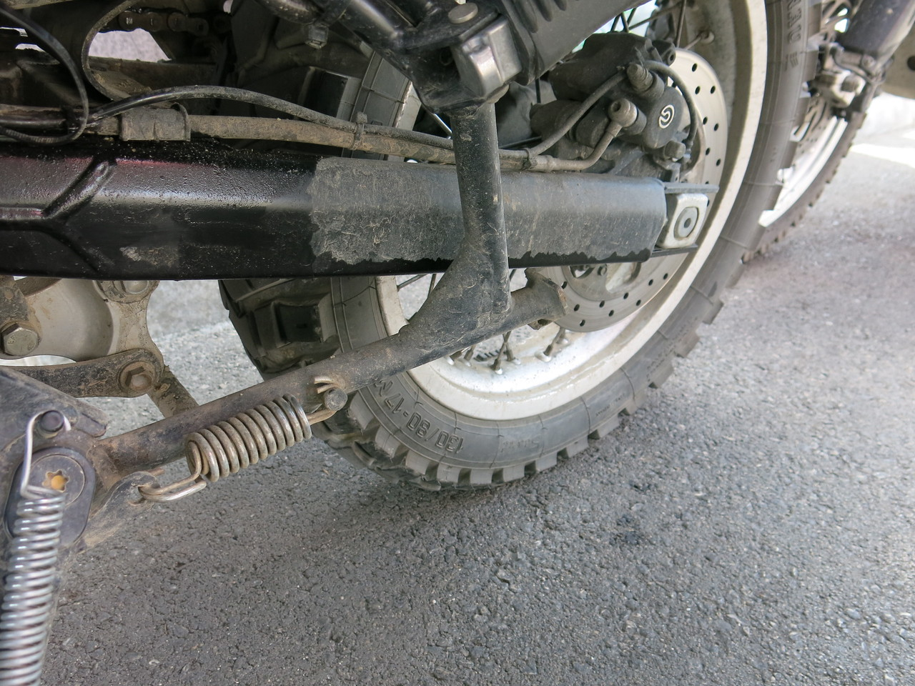 Swingarm covered in oil from a leaky rear shock