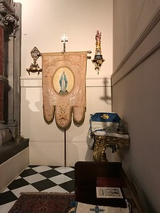 Credence table & Banner of Our Lady, assorted reliquaries