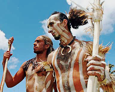 Easter island, CHILE:  TO GO WITH STORY : CHILI-TOURISME-ECONOMIE BY PAR GILLES BERTIN  (FILES) A file photo taken 12 February 2005 on the Easter Island, Chile, shows two men dressed as Rapanui warriors. Mistreated for centuries by tribal wars, proslavers and adventurers, the 3800 residents of the island fight to keep their originality coping with the thousands of tourists coming every year.              AFP PHOTO / MARTIN BERNETTI  (Photo credit should read MARTIN BERNETTI/AFP/Getty Images)