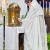 Fr. Tim Thompson, pastor of Immaculate Conception Church, places the Eucharist in the tabernacle prior to Adoration.