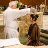 An RCIA candidate is baptized by Father Richard Eldredge.