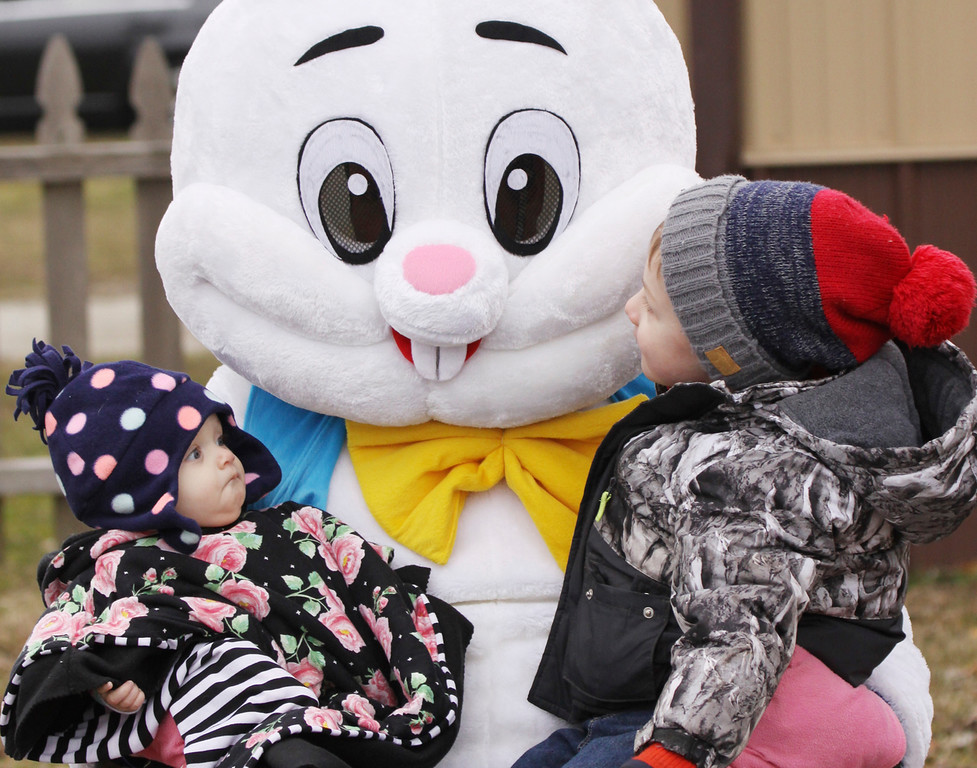 . Children meet the Easter Bunny, played by Ross Ratliff, during the La Porte, Ind., Jaycees\' Easter Egg Hunt on Saturday, March 31, 2018 at the county fairgrounds. (Paul Kemiel/The News-Dispatch via AP)