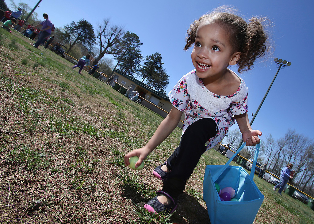 . Three-year-old Endy Chapman picks up another egg during the 8th annual Ranlo Easter Egg Hunt on Saturday,  March 31, 2018 at Ranlo Park, N.C. (Mike Hensdill/The Gaston Gazette via AP)