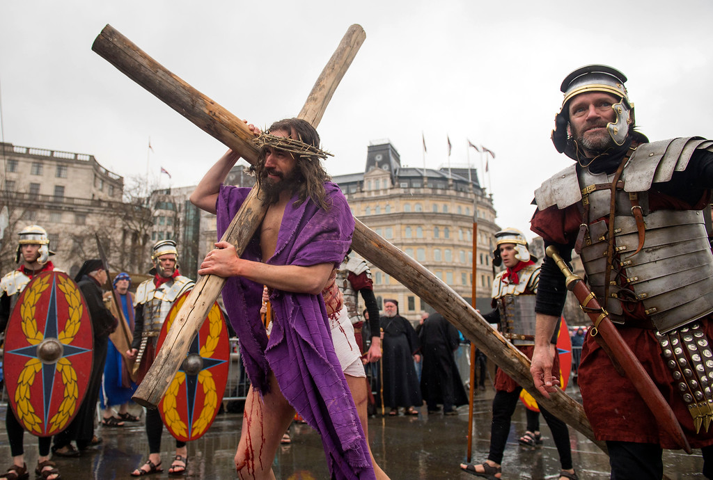 . James Burke-Dunsmore as Jesus in the Good Friday performance of the Passion of Jesus, staged by the Wintershall Players, in Trafalgar Square, London, Friday March 30, 2018. (Dominic Lipinski/PA via AP)