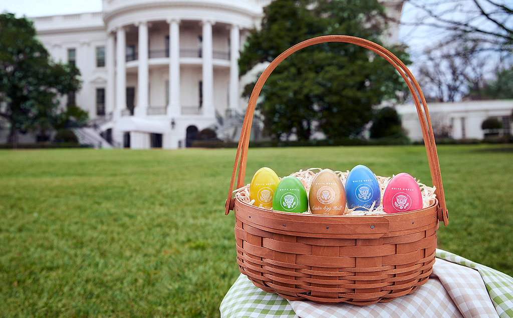 . In this 2018 photo provided by the White House Historical Association, colorful eggs created at Maine Wood Concepts in New Vineyard, Maine, are displayed outside the White House in Washington. Some of the 110,000 keepsakes created for the association will be used in the White House Easter Egg Roll on Monday, April 2. (David Wiegold/White House Historical Association via AP)