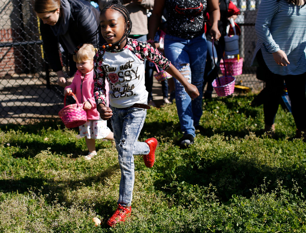 . Local kids hunt for Easter eggs at Rocksprings Park in Athens, Ga., Saturday, March 31, 2018. (Joshua L. Jones/Athens Banner-Herald)