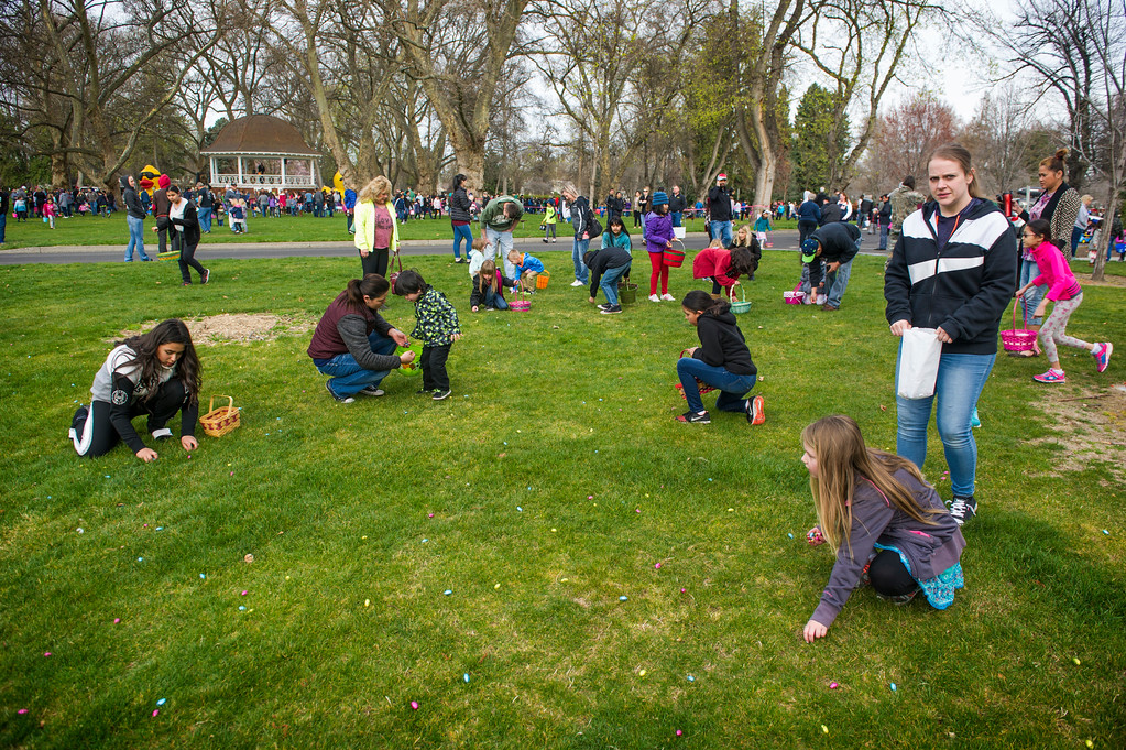 . Thousands of children swarm Pioneer Park in Walla Walla, Wash., during the 59th Annual Children\'s Easter Egg Hunt, Saturday, March 31, 2018. (Greg Lehman/Walla Walla Union-Bulletin via AP)