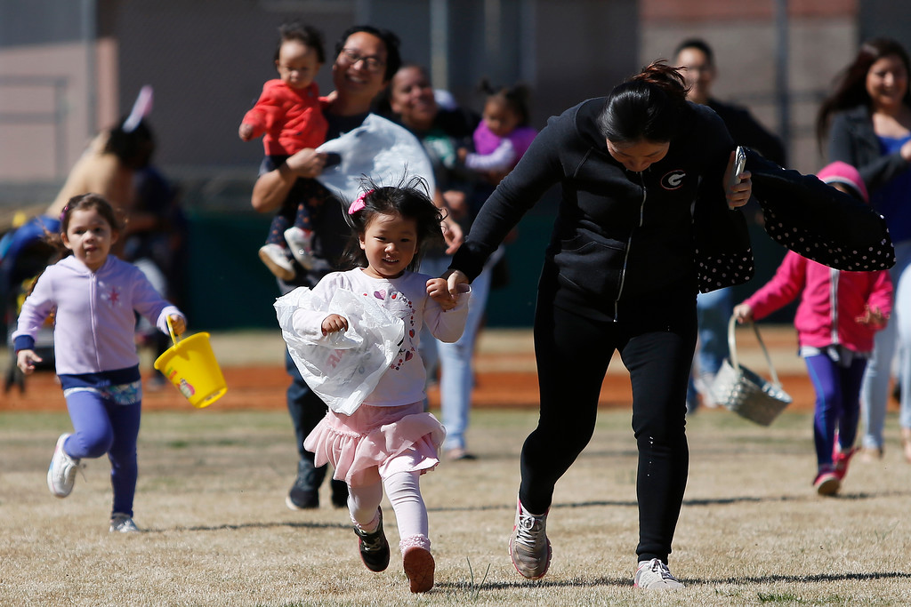. Local kids race for Easter eggs at Lay Park in Athens, Ga., Saturday, March 31, 2018 (Joshua L. Jones/Athens Banner-Herald)/