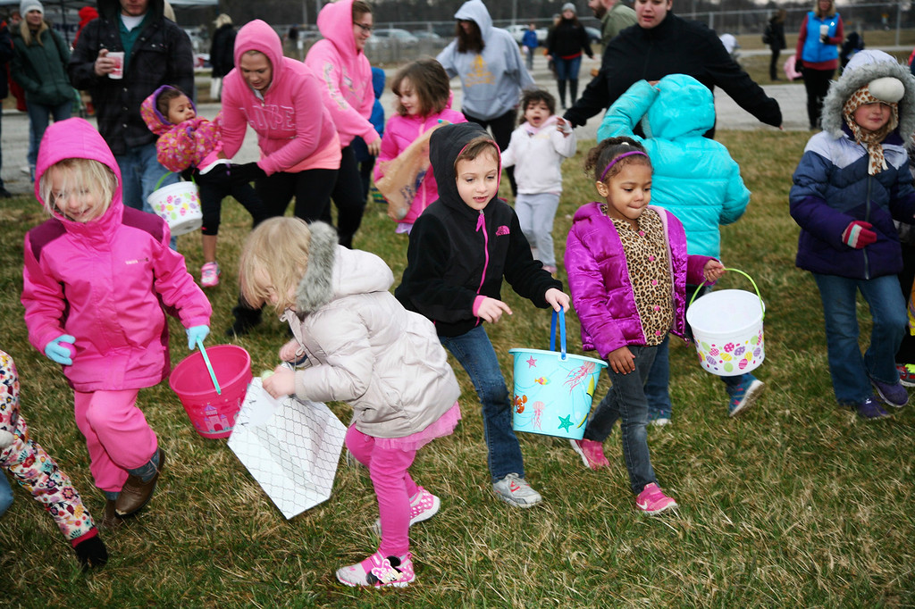 . Children scramble for eggs during the La Porte, Ind., Jaycees\' Easter Egg Hunt on Saturday, March 31, 2018 at the county fairgrounds. (Paul Kemiel/The News-Dispatch via AP)