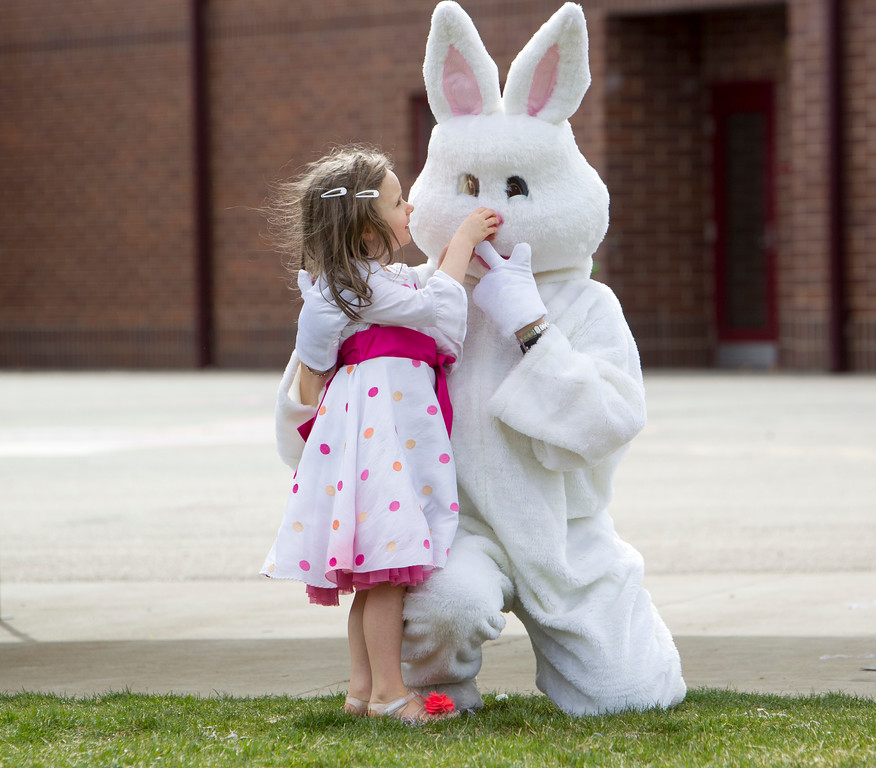 . Lilly Warde\'s interacts with the Easter bunny during the Autism Society Treasure Valley\'s annual sensory-friendly Easter egg hunt on Saturday, March 31, 2018, at River Valley Elementary School in Meridian, Idaho.   (Katherine Jones/Idaho Statesman via AP)