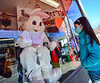 Sienna Borek, 8, of Brattleboro, Vt., meets a socially distanced Easter Bunny, who was behind glass at Brown and Roberts Ace Hardware, in Brattleboro, Vt., during the COVID-19 pandemic, on Saturday, April 3, 2021.
