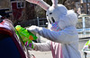 The Easter Bunny, wearing a mask, gives baskets to children at the Rockingham Recreation Center, in Bellows Falls, Vt., on Saturday, April 3, 2021.