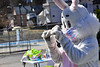 The Easter Bunny, wearing a mask, waves to children at the Rockingham Recreation Center, in Bellows Falls, Vt., on Saturday, April 3, 2021.