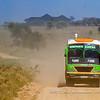 A bus from Serengeti Liners crossing the Serengeti National Park, Tanzania