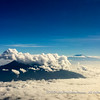 Mount Meru and Mount Kilimanjaro sticking out above the clouds