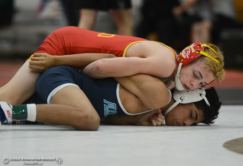 . In the 108 bout, Chico High\'s Xavier Gower wrestles Pleasant Valley High\'s Edgar Romero-Hernandez during the Eastern Athletic League Championships, Saturday, February 10, 2018, in Chico, California. (Carin Dorghalli -- Enterprise-Record)