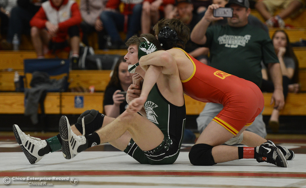 . In the 115 bout, Chico High\'s Jacob Hiller wrestles Red Bluff High\'s Aj Strole during the Eastern Athletic League Championships, Saturday, February 10, 2018, in Chico, California. (Carin Dorghalli -- Enterprise-Record)
