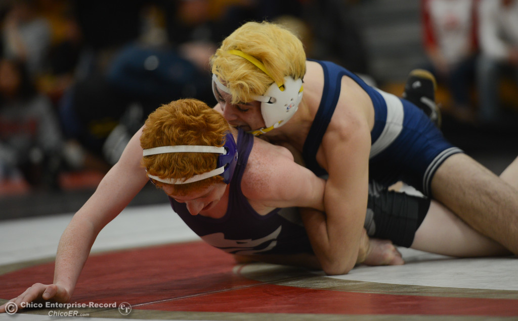 . In the 122 bout, Pleasant Valley High\'s Jake Mora wrestle Shasta High\'s Cj Rosie during the Eastern Athletic League Championships, Saturday, February 10, 2018, in Chico, California. (Carin Dorghalli -- Enterprise-Record)