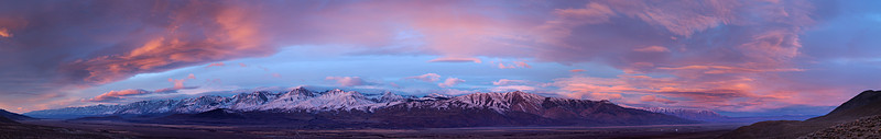 A winter storm obscures the tops of the Sierra peaks. Overcast covers the Owens Valley. To the east there is clear dry air over Death Valley. For a few minutes at sunrise the light catches the bottom of the Owens Valley gloom with red and gold. After 15 minutes, the sun disappears for the rest of the day.<br /> <br /> The next two images give greater detail.
