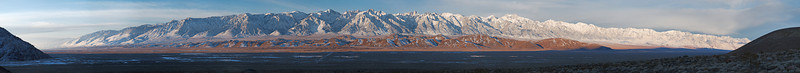 """Sunrise in the Owens Valley and on the Sierra Nevada A distant Olancha Peak shows at the far left skyline. Tinemaha Peak is on the far right skyline. This spans 55 miles of the Sierra crest.  <a href=""""http://www.dbdimages.com/photos/896172467_NF6TE-O-1.jpg""""TARGET=""""blank"""">View large in another window.</a> Use your viewer's zoom function if necessary."""