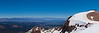 Panorama from the top of the Cornice. The top of Chair 22 in the foreground, the White Mountains on the skyline, the top of the Panorama Gondola to the right.<br /> June 17, 2010