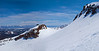 Looking across the cornice to the top of Chair 3 anf the distant White Mountains.
