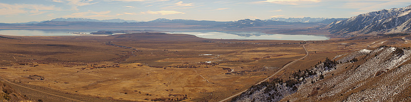 """From the overlook at the top of the Conway Grade, the White Mountains ride the skyline to the left and the Sierras on the right. Mono Craters are reflected in Mono Lake. Negit and Paoha Islands show over the volcanic Black Point on the north shore.  <a href=""""http://www.dbdimages.com/photos/809924335_6Pjdg-O.jpg""""TARGET=""""blank"""">View large in another window.</a> Use your viewer's zoom function if necessary and be sure to use the sliders."""