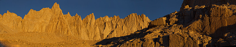 "For Mount Whitney day-hikers, the orange light of dawn on the Sierra crest above Trail Camp is often the irresistible first photographic opportunity of the day. The image runs nearly to Trail Crest on the left to the shadowed shoulder of Wotan's Throne on the right. Mount Muir is the highest (but not the most prominent) peak on the skyline.  <A HREF=""http://dbdimages.smugmug.com/photos/200988420-O.jpg""TARGET=""blank"">View Larger Image</A> (And use your browser's zoom if necessary.)"