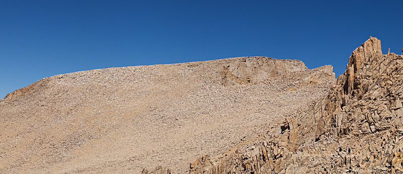 The southwest slopes of Mount Whitney are a huge boulder field. Rock motion from freeze-thaw cycling alters the slope and makes trail maintenance difficult. After wet winters, snow banks can cover portions of the trail here throughout the summer. After the dry winter of 2006/2007 no snow remains.