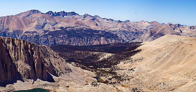 Below the west side of Whitney, Whitney Creek drains into the Kern Canyon in the middle distance. The Kaweah Peaks Ridge forms the distant skyline.<br /> <br /> The Kern Canyon was formed by glacial ice, accumulated on the southern Sierra highlands carving an exit to the south.