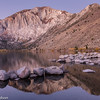 A line of boulders in Convict Lake with Laurel Mountain in the eastern Sierras.