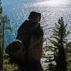 A boulder overlooks the sunlit waters of Lake Tahoe.