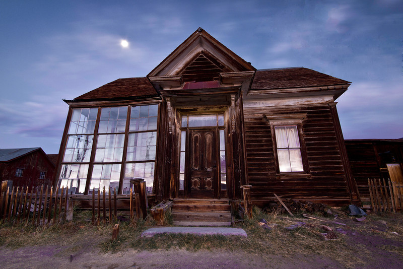 The Cain house at dawn with the moon setting to the West, and Eastern sky reflected in the windows