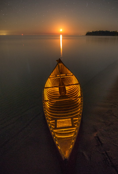 Orange Moonset over Lit Canoe