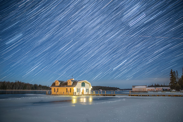 Winter Star Trail and Airplane over Yellow Boathouse