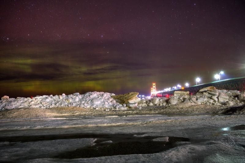 Ice plies and aurora at the Mackinac Bridge