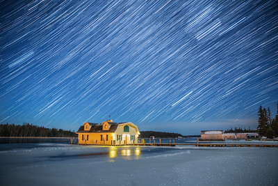 Winter Star Trails over Yellow Boathouse