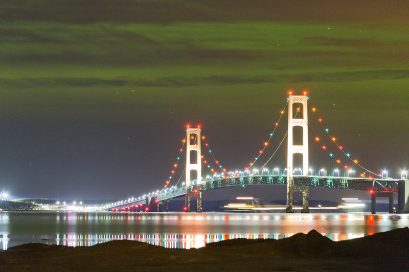 Freighter under the northern lights and the Mackinac Bridge