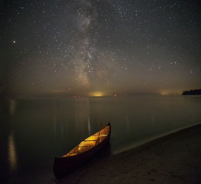 Lit Canoe under the Milky Way