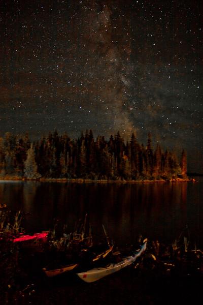 Kayaks under the Milky Way