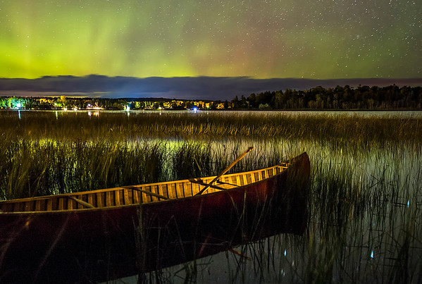 Red Canoe under the Northern Lights