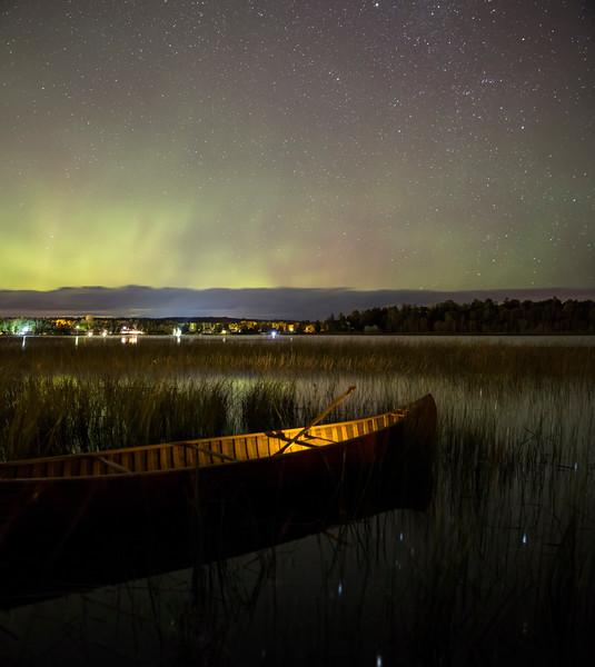 Lit Canoe under the Northern Lights