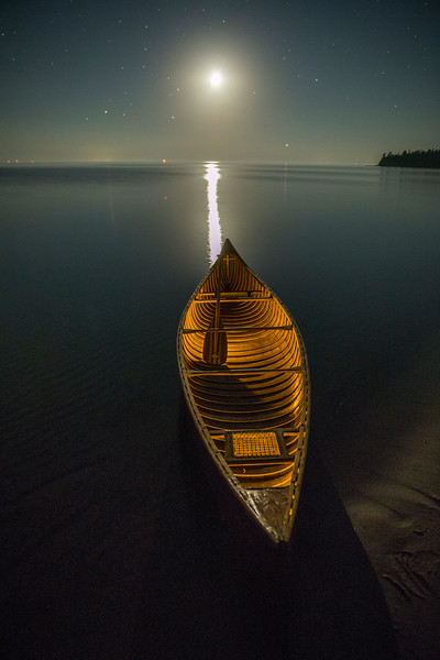 Lit Canoe at Moonset