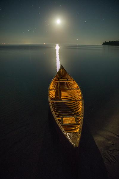Lit Canoe at Moonset