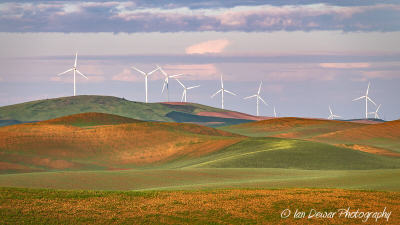 On a hilltop in the Palouse Region of Eastern Washington wind turbines generate clean electricity