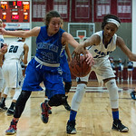 Figting for a rebound were CAL\'s Camryn White (00) and Eastern\'s Mikayla Kinnard (12).