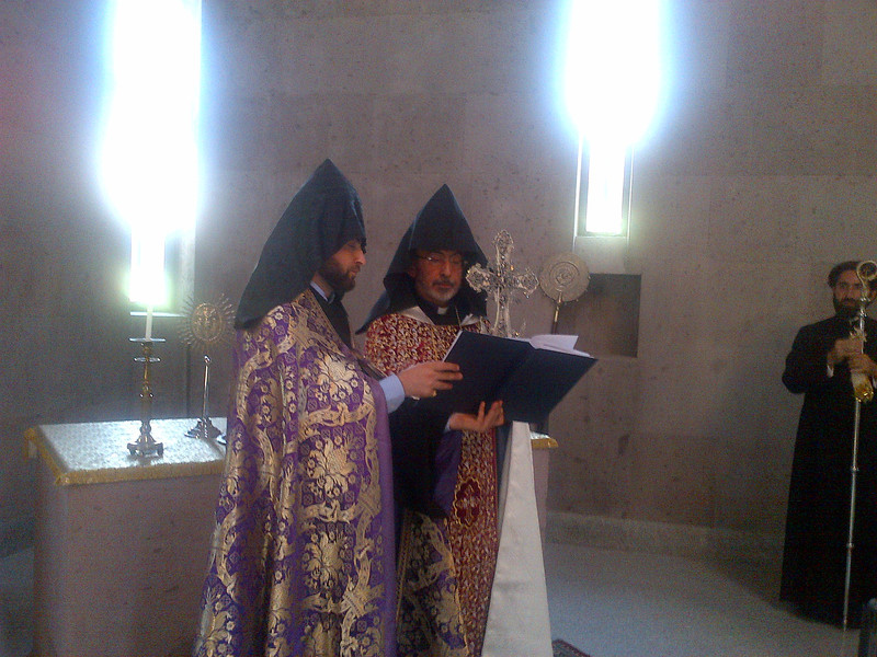 In the baptistry at Holy Etchmaidzin, a service of blessing and consecration is performed over the hand-made silver cross containing a relic of St. Vartan.