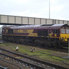 66017 in a very heavy shower after arriving with 6X44 Southampton - Eastleigh with a couple of crippled FKAs